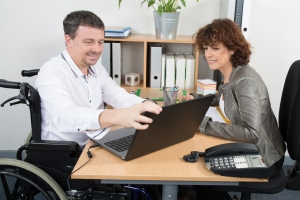 Smiling business man disabled interviewing candidate in an office