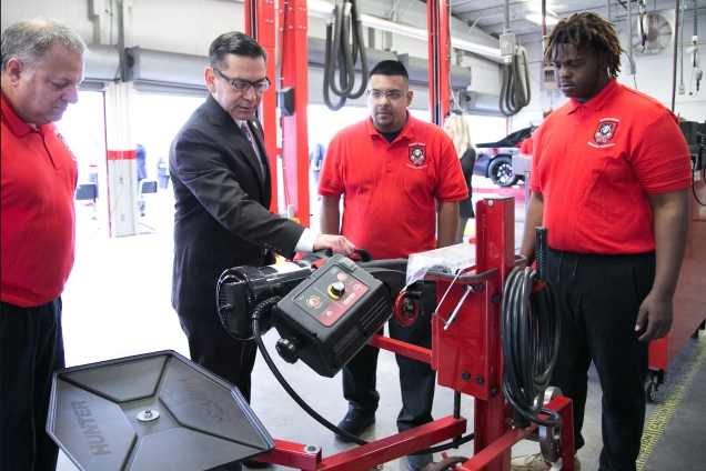 Waco High School Automotive Technology class demonstrates classroom equipment. From left: Waco High Auto Tech Teacher Casey Daugherty, TWC Commissioner Representing Labor Julian Alvarez, Waco High Auto Tech Teacher Mario Chavez and Waco High Student Ladaruis Rollings.