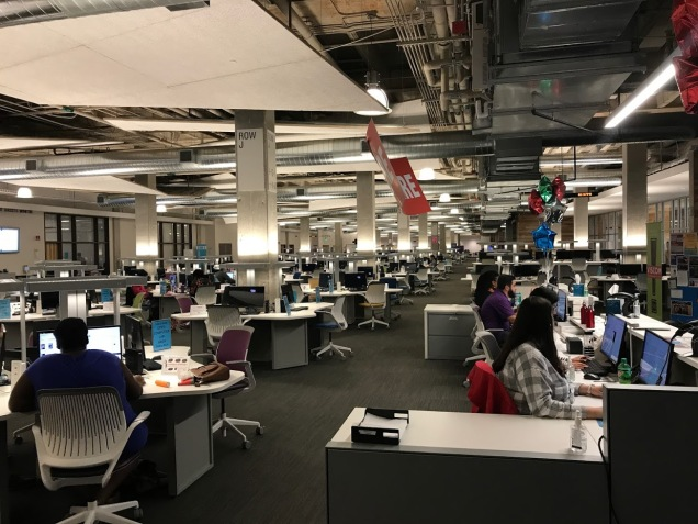 Inside view of the large internal area of the Austin Community College ACCelerator Laboratory, which is filled with computer on desks.
