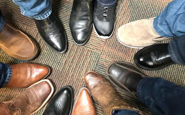 Each member of the Texas Two Step Boot Tour placed one of their shoes in the form of a circle to symbolize unity.