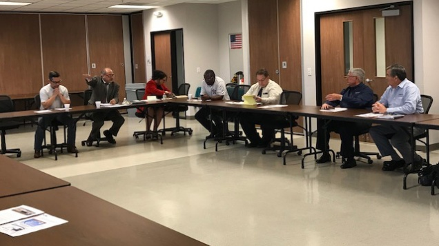 Members of the Two Step Tour and Workforce Solutions Alamo meet around a table with stakeholders in Hondo.