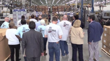 The group tours the inside of the Royal Technologies work space