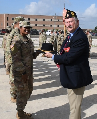 PHOTO: John McKinny with the American Legion - Department of Texas, presents a Cavalry Stetson to a U.S. Army soldier with the 3rd Brigade Engineer Battalion of the 1st Cavalry Division.