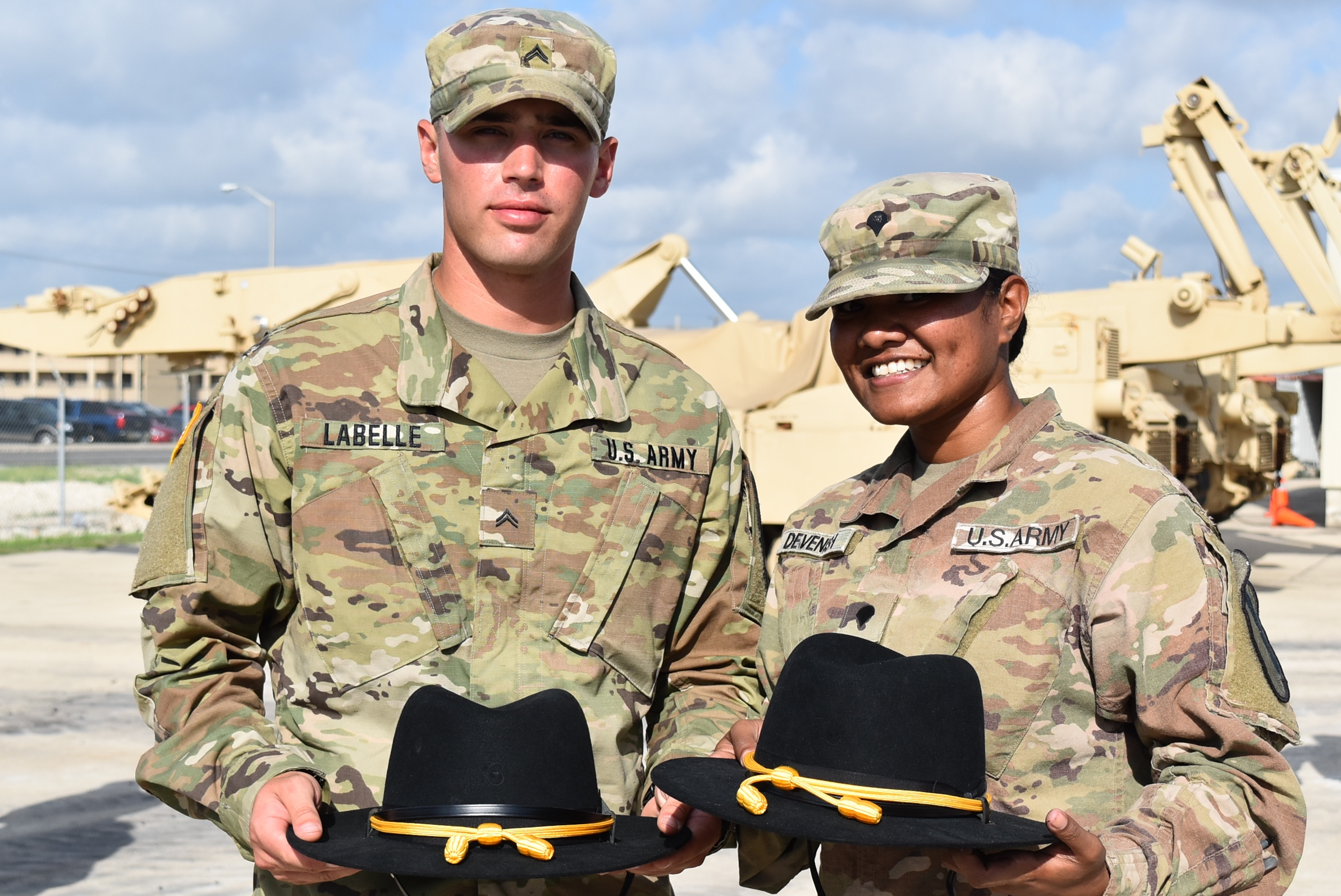 PHOTOS: PHOTO: Soldiers with the 3rd Brigade Engineer Battalion show off their new Cavalry Stetsons.