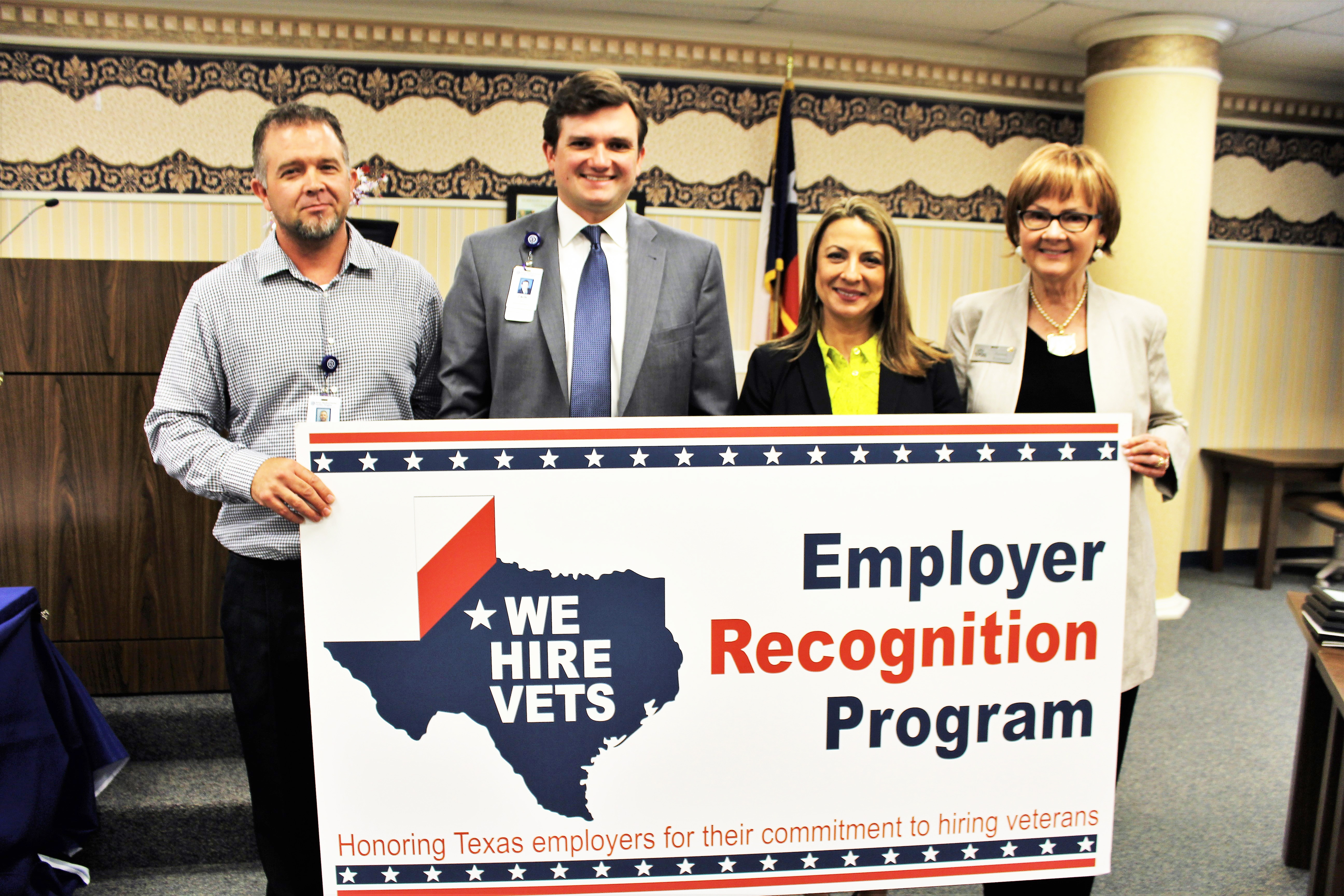 "PHOTO: (L) Michael Hales, RN at Seton Medical Center Harker Heights, Zachary K. Dietze, CEO of Seton Medical Center Harker Heights, TWC Commissioner Representing Employers Ruth R. Hughs, and Central Texas Workforce Development Board Executive Director Susan Kamas, at the Killeen ""We Hire Vets"" event."