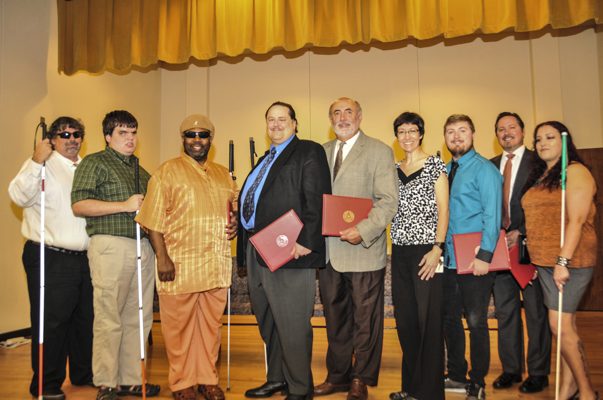 Lary Temple participating in a graduation ceremony at the Criss Cole Rehabilitation Center, an innovative, residential vocational rehabilitation training facility serving adults who are legally blind.
